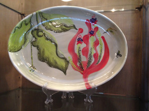 "Oval Plate With Hosta Leaves and Red Foliage, by Julie ""Jules"" Webster, alumna"