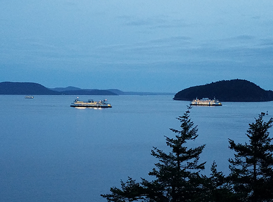 Ferries going by at night