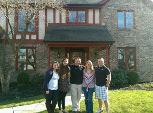 Last family photo in front of home before the move