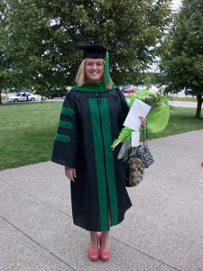 Nicole Dominiak smiled for the camera after receiving the doctor of medicine degree at UT in 2012.